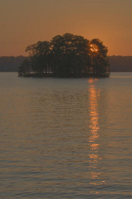The sun rises over Lake Lanier
